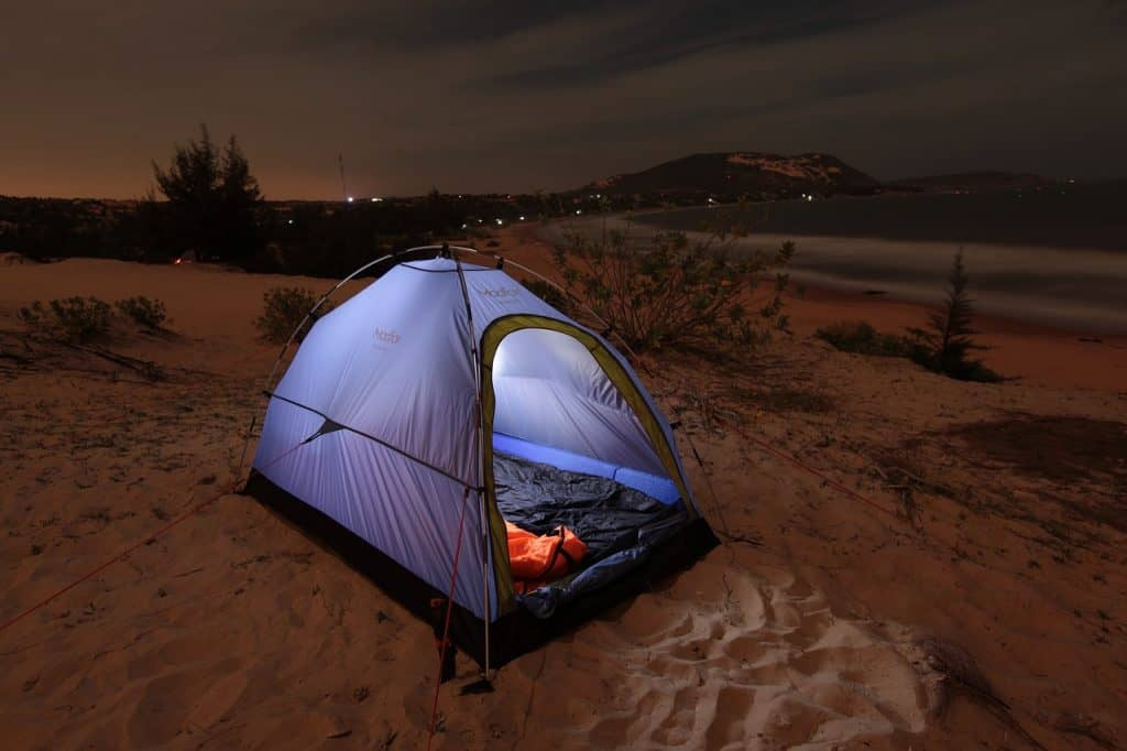 best tent stakes for sand , picture of a tent at night in desert with guy lines