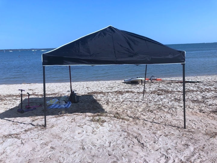 Canopy setup on beach with some childrens toys underneath, how to take down a canopy