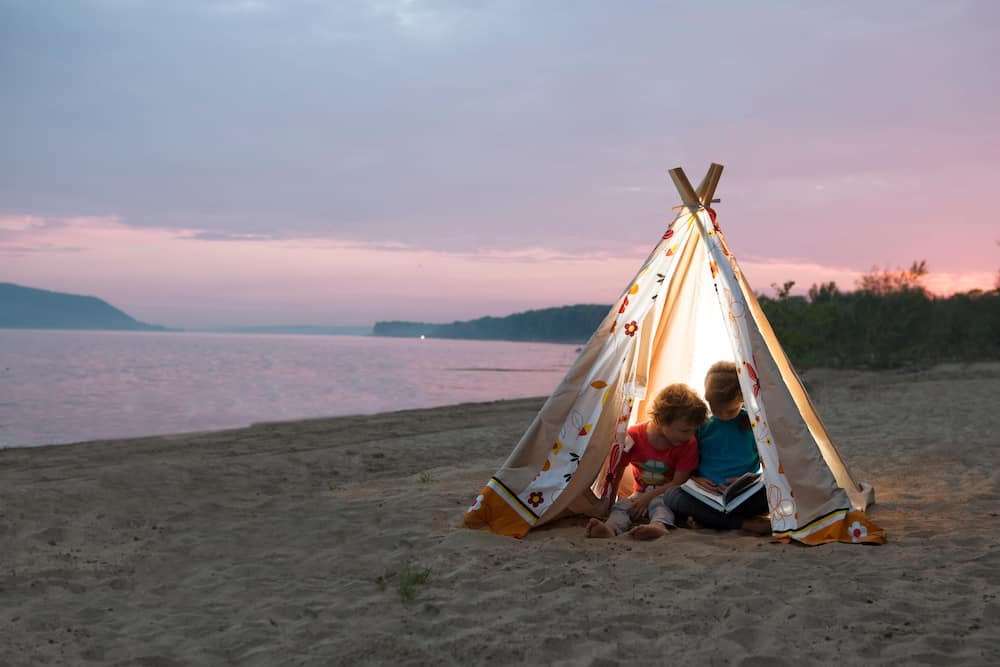 best beach canopy for family kids sitting under a teepee